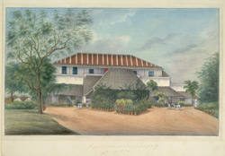 A substantial house with balcony and portico set in a garden, with Indian attendants and a syce and horse waiting.